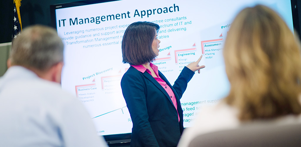 a woman giving a presentation for i.t management